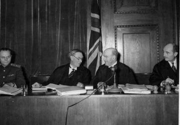 Members of the Nuremberg Tribunal Iona Nikitchenko (USSR), Norman Birkett and Geoffrey Lawrence (UK) and Francis Biddle (US)