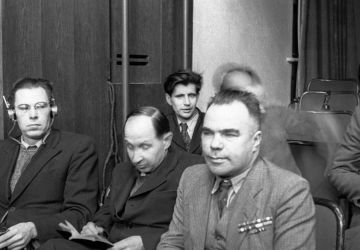 Writer Vsevolod Vishnevsky and artists of the Kukryniksy collective Porfiry Krylov and Mikhail Kupriyanov (from right to left) sit in a courtroom. The Nuremberg trial.