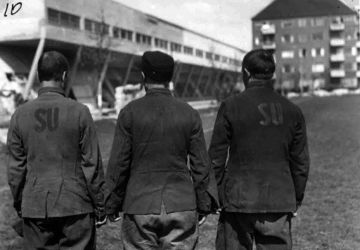 """The inscription """"SU"""" (Soviet Union) on the clothing is a distinctive sign of a Soviet prisoner of war.  Denmark, a POW camp, 1945. State Archive of the Russian Federation / F. 9526. Op. 4.D.65. Sheet 1"""
