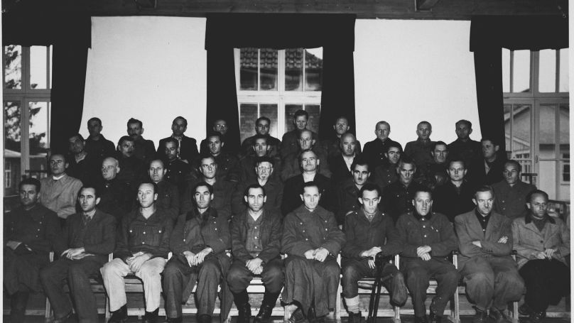 Group portrait of the defendants in the Dachau war crimes trial.