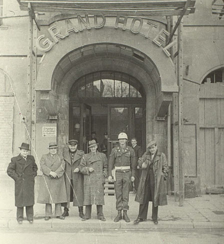 At the entrance to the Grand Hotel in Nuremberg.  Second from the left is Soviet writer and journalist V. Vishnevsky, third from the left is Soviet director R. Karmen.  The Russian State Archives of Literature and Arts.