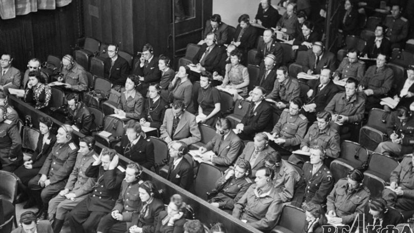 Representatives of the international press follow the publication of the materials of the Soviet prosecution at the Nuremberg trials (February 1946). Photographer Evgeny Khaldei. RGAKFD Arch. No. В-2455