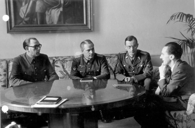 Generals Andrei Vlasov and Georgy Zhilenkov meeting Joseph Goebbels, Minister for Public Enlightenment and Propaganda of the Third Reich, 28 February 1945. Bundesarchiv, Bild 183-H27774 / CC-BY-SA 3.0
