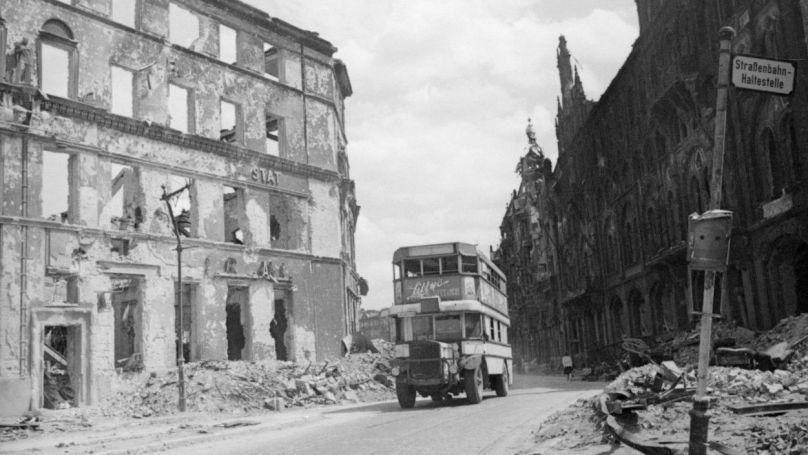 "Bus on a destroyed street in Berlin. 8 June 1945 ""General Berzarin's Last Act of Heroism"" project. / Kinelovsky V.S."
