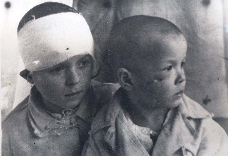 "Children of Ivanovka, a Nazi- ravaged village, Stalingrad Region, 1943 State Archive of Volgograd Oblast, Photo Catalogue, Acc. No. 19488 © Web Portal ""Nazi Crimes in the USSR"""