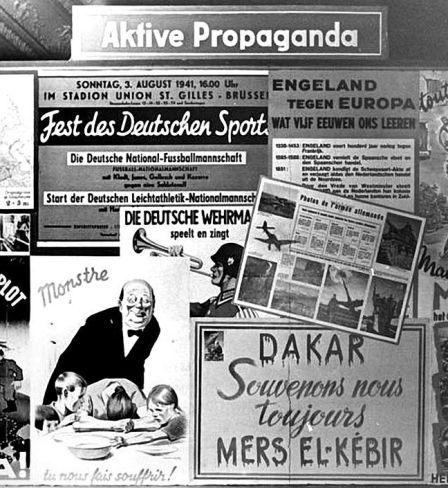 Wandtafel in einer Ausstellung über die Arbeit der Propaganda-Abteilung in Belgien, um Dezember 1941/Januar 1942