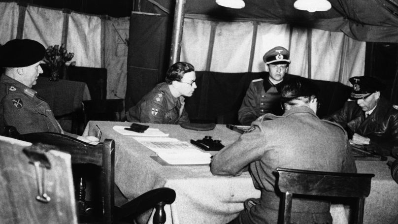British Field Marshal Bernard Montgomery (left) and representatives of Admiral Dönitz and Field Marshal Keitel discuss conditions of the German army's surrender on 3 May 1945