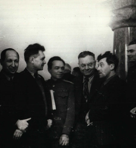 Procurator General of the Soviet Union Roman Rudenko on a smoke break with journalists.