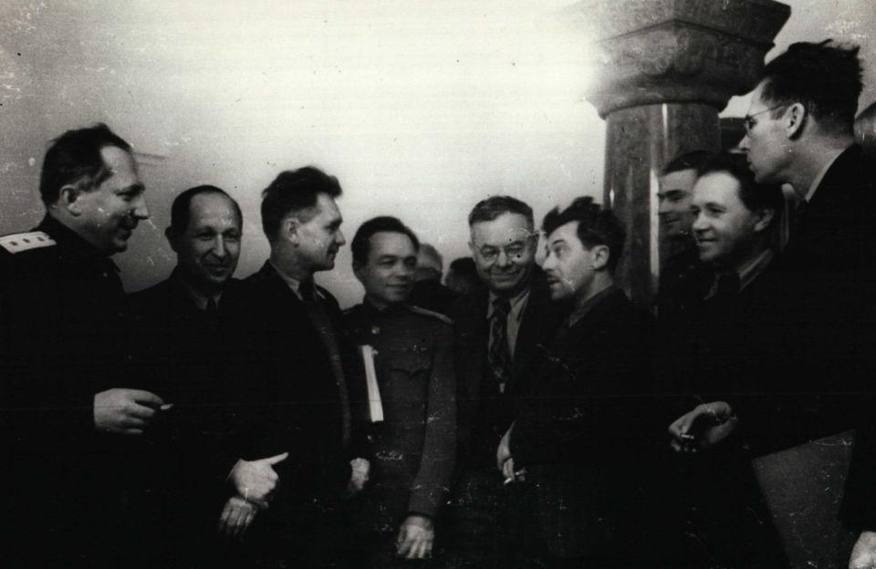 Procurator General of the Soviet Union Roman Rudenko on a smoke break with journalists.