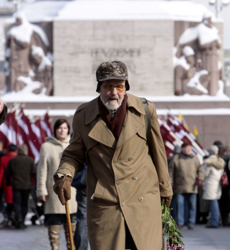 Latvian legionnaire walks to lay flowers to the Freedom Monument in Riga on the anniversary of the foundation of the Latvian Legion, a formation of the German Waffen-SS.