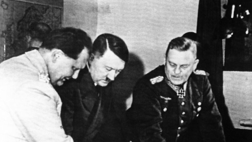 Adolf Hitler studies a war map with Reichs Marshal Hermann Goering at a place described by German sources a Hitler's headquarters on the eastern front in July 1941. Field Marshal Wilhelm Keitel (right) looks on. German sources did not state the date the picture was taken this picture was send by radio from Berlin to New York on July 21.