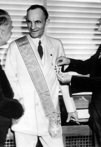 German diplomats award Henry Ford, center, Nazi Germany's highest decoration for foreigners, The Grand Cross of the German Eagle, in Detroit on July, 30, 1938 for his  service  to the Third Reich.  Karl Kapp, German consul in Cleveland pins the medal while Fritz Heiler, left, German consul in Detroit shakes his hand. General Motors Corp. and Ford Motor Co. deny helping the Nazis during World War II and profiting from forced labor at their German subsidiaries.  (AP Photo)