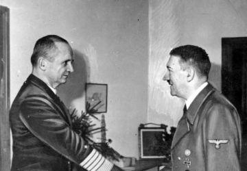 "Adolf Hitler receives the commander of the Navy, Grand Admiral Karl Dönitz, in the ""Führerbunker""."