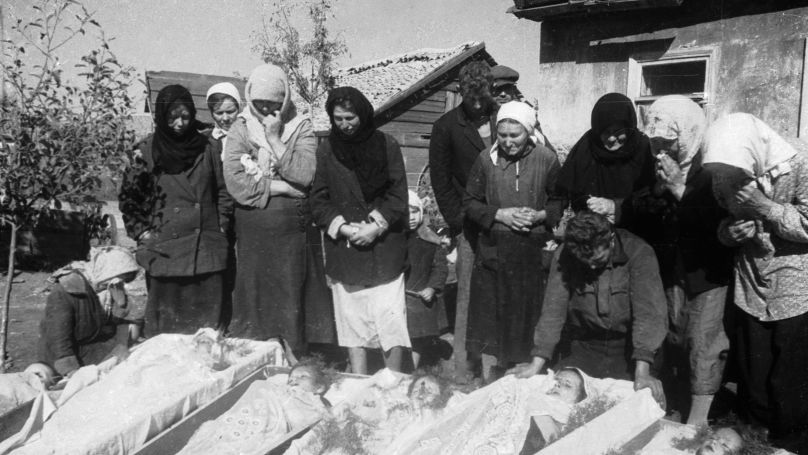 Residents of a village in Donbass at a funeral for women, the elderly, and children massacred by the Nazis.