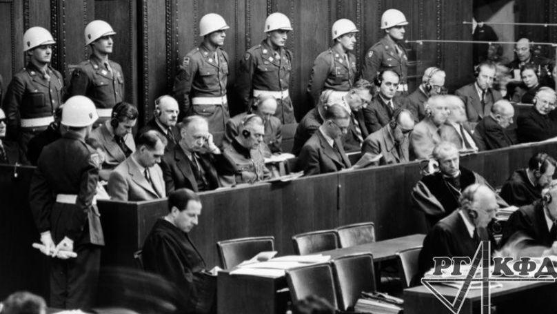 "In the dock: 1st row (from left to right): G. Goering, R. Hess, I. von Ribbentrop, V. Keitel, E. Kaltenbrunner, A. Rosenberg, G. Frank, V. Frick, J. Streicher, V. Funk, J. Shakht; 2nd row: K. Doenitz, E. Raeder, B. von Schirach, F. Sauckel, A. Jodl, F. von Papen, A. Seyss-Inquart, A. Speer, K. von Neurath, G. Fritsche. December 1945. // Russian State Archive of Film and Photo Documents Arch. No. В-3127. © Portal ""Crimes of the Nazis in the USSR"""