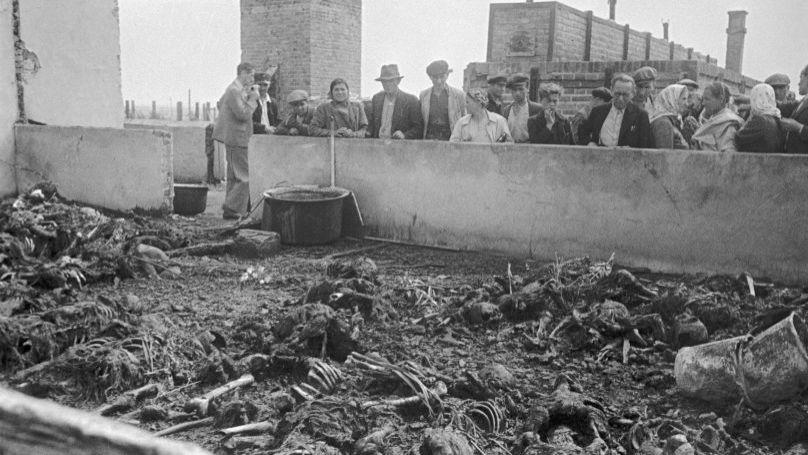 People look at human remains at the Majdanek concentration camp