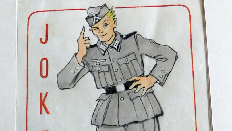 The joker in the deck is depicted as an ordinary German soldier. And the capture reads: even though I stay invisible in the deck for long, when the time comes, I become the most important card because I make my own decisions.